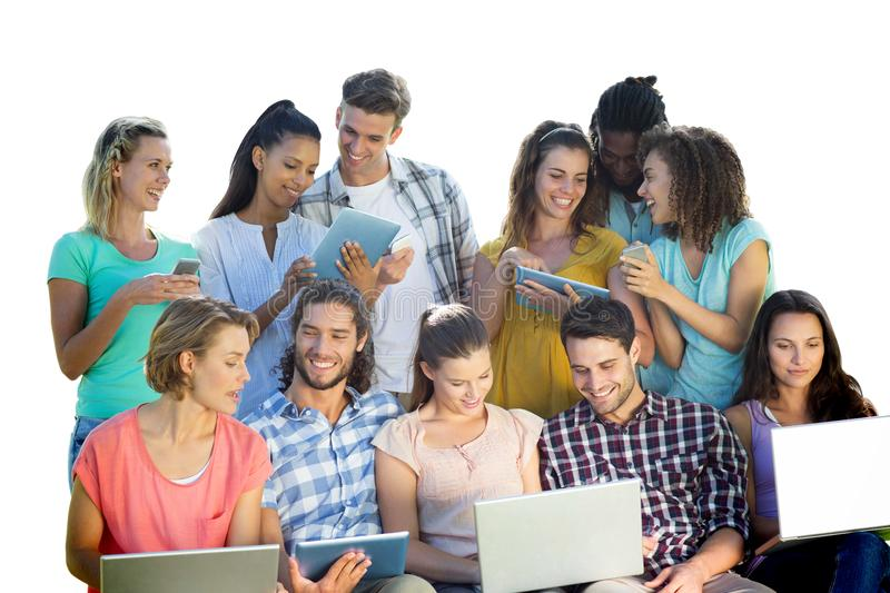 Composite image of several students using electronic devices stock photography