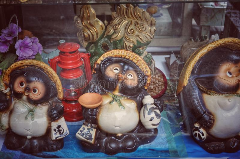 Tanuki in Tokyo, Japan. Several tanuki on sale in front of a souvenir shop in Sumida district, Tokyo stock photography