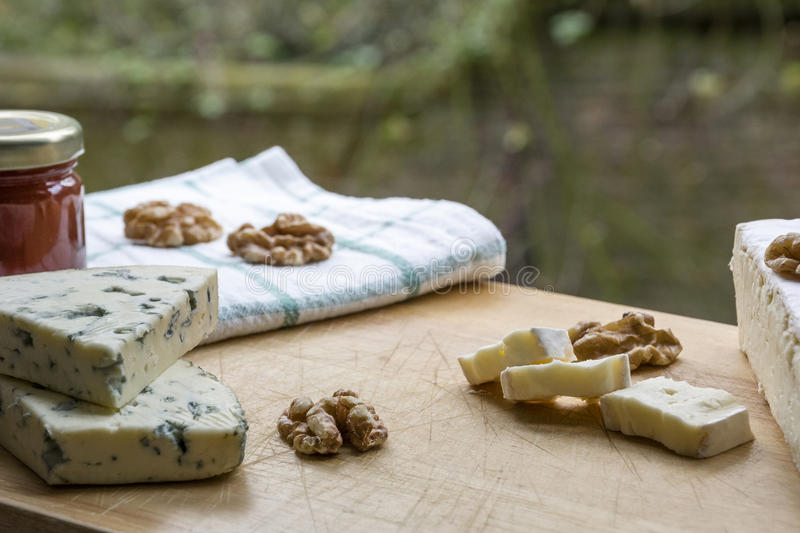 Several tasty pieces of brie and roquefort cheese royalty free stock photos