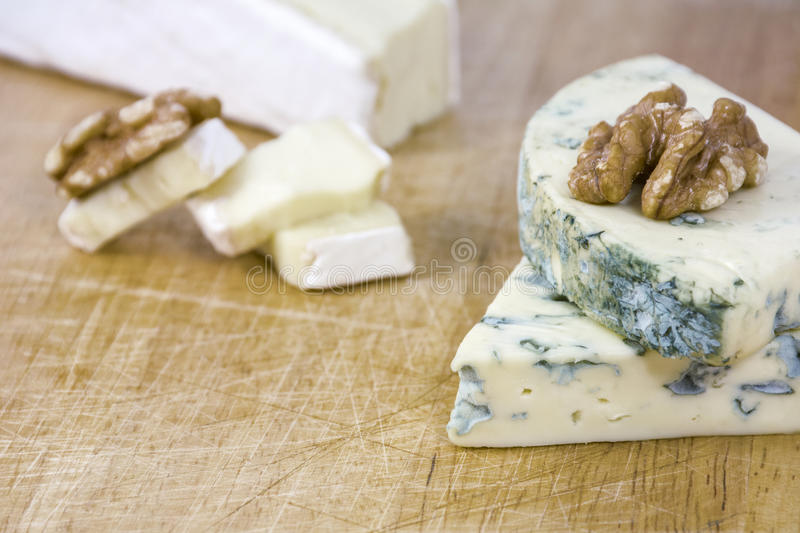 Several tasty pieces of cheese roquefort and brie royalty free stock photos