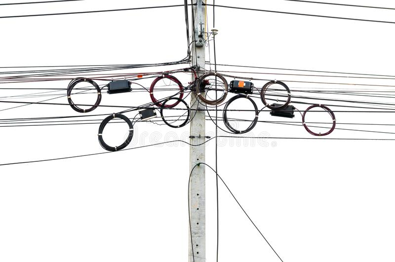 Telecommunication lines hangs on electric pole. Several telecommunication line left as roles hanged on other wires on electric pole. Mostly fiber optic left royalty free stock photography