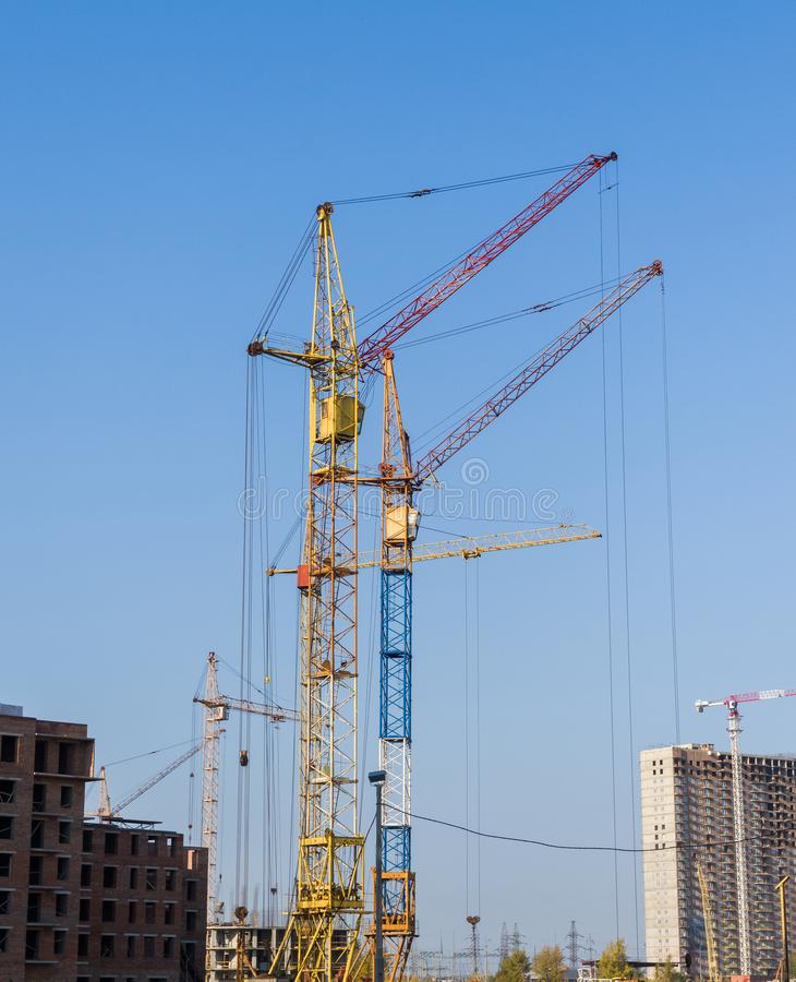 Several tower cranes are active. Construction and industrial development stock photos