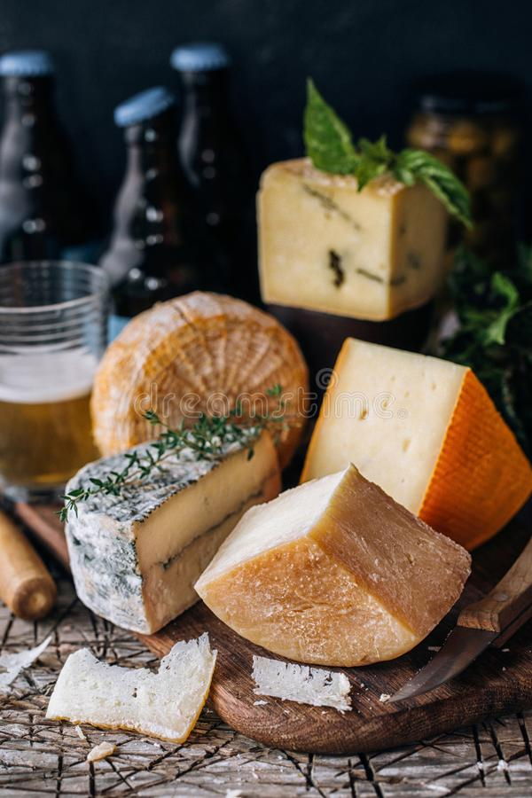 Several types of cheese and beer stock image