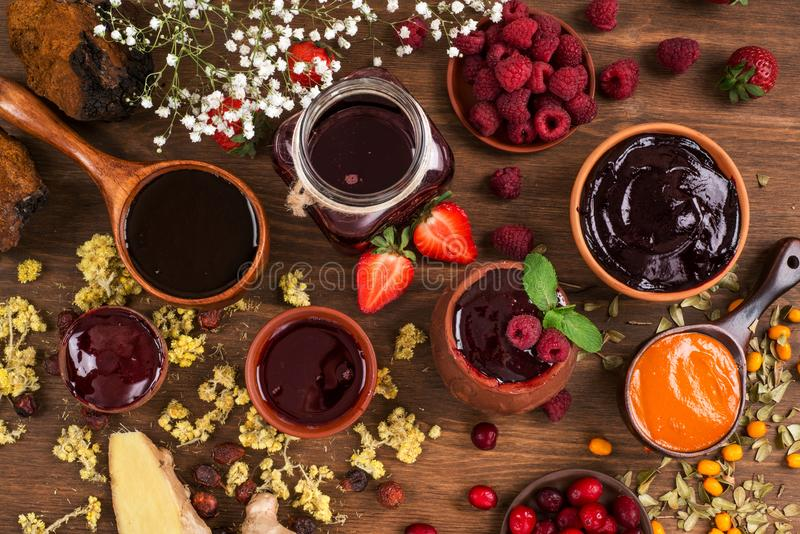 Several types of jam on a wooden table stock photo