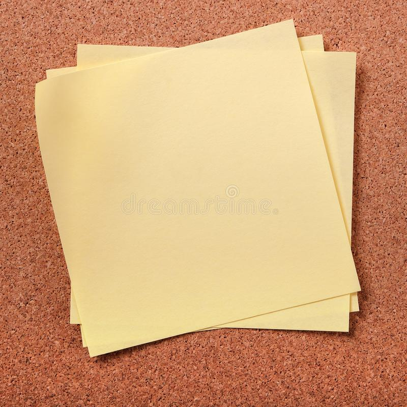 Several untidy sticky post notes on cork board background royalty free stock images