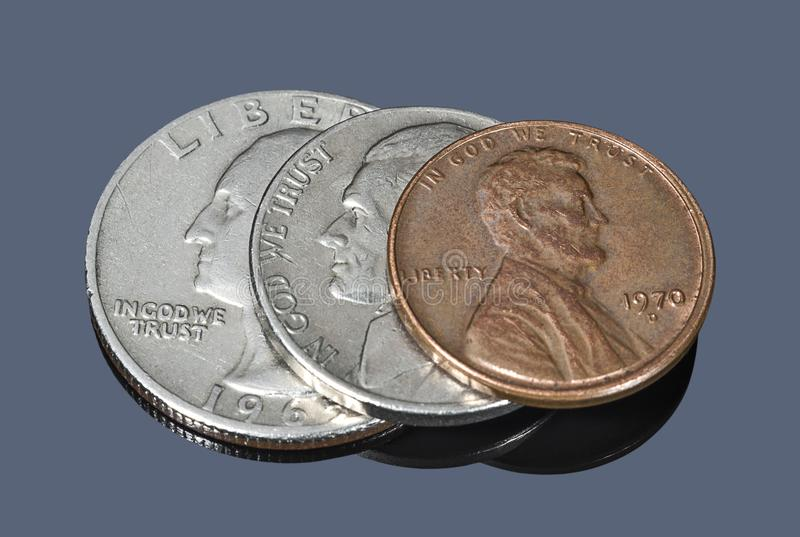 Several US coins against a dark background stock image