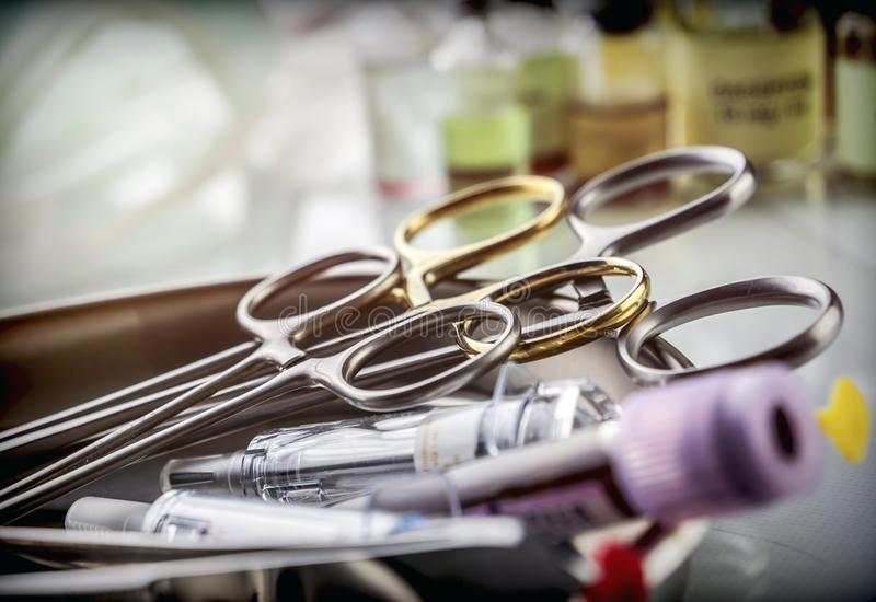 Several vials and scissors of suture in a laboratory in a hospital, royalty free stock images