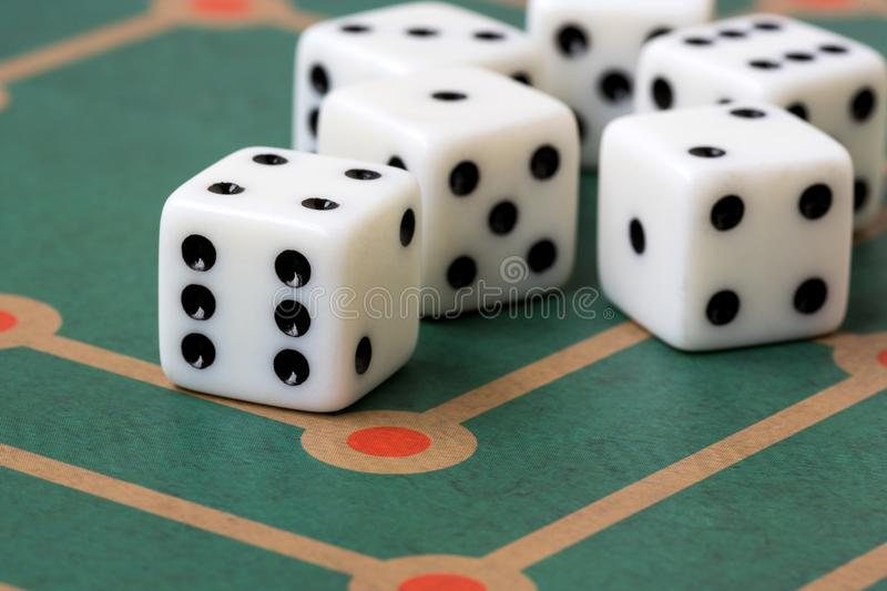 Dices on  board game background. Several white dices on  board game background royalty free stock photography