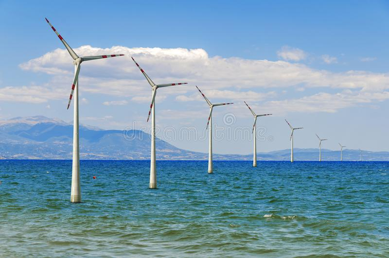 Several wind sea offshore turbine for green alternative sustainable electricity royalty free stock photos