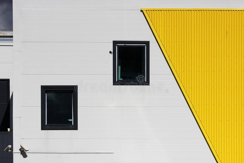 several windows and video cameras in a large shopping center on a beige and yellow background, facade royalty free stock photos