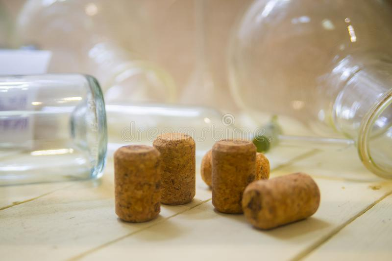 Several wine corks and glass flasks laboratory stand on wooden surface close royalty free stock images