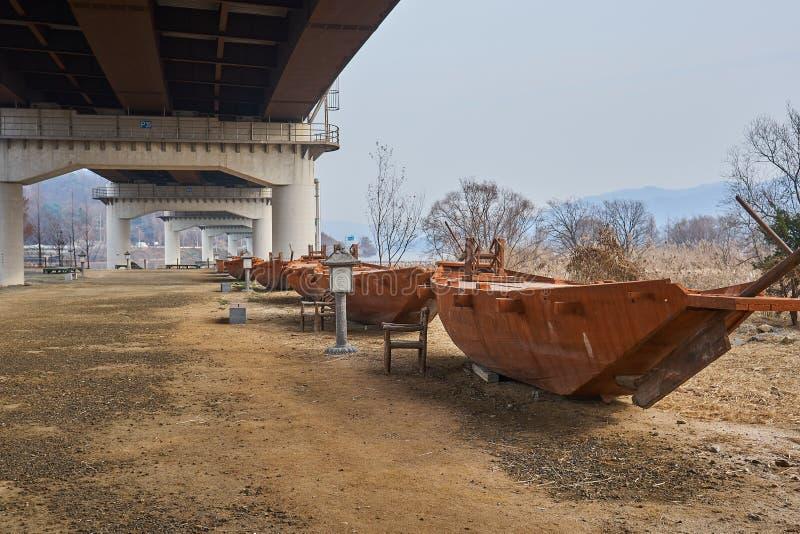 Boats displayed under a bridge on land at Semiwon, South Korea royalty free stock photos