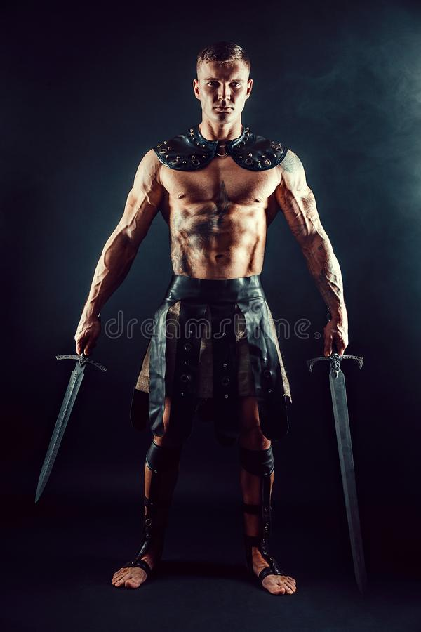 Download Severe Barbarian In Leather Costume With Sword Stock Image - Image of historic costume : leather gladiator costume  - Germanpascual.Com