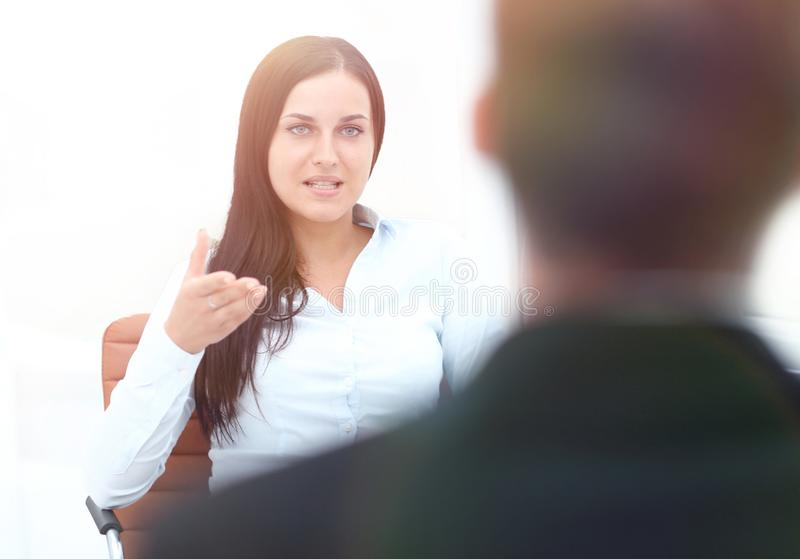 Severe female manager criticize her team member stock photography