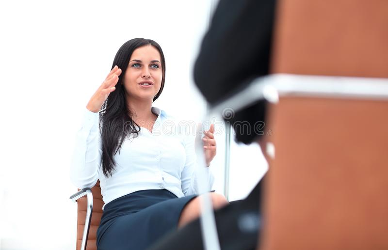 Severe female manager criticize her team member stock images