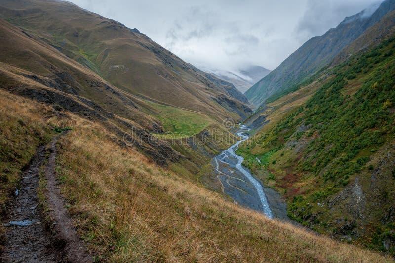 Severe mountain landscape with Khvahidistskali river in Tusheti, Georgia stock photography