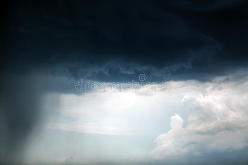 Clouds and Rain. Severe Rain and Dark and Dramatic Storm Clouds royalty free stock images