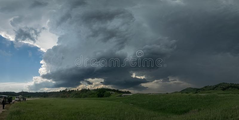 Panoramic view of a supercell thunderstorm over the Black Hills in South Dakota. This severe rotating storm produced some very large hail which demolished the stock image
