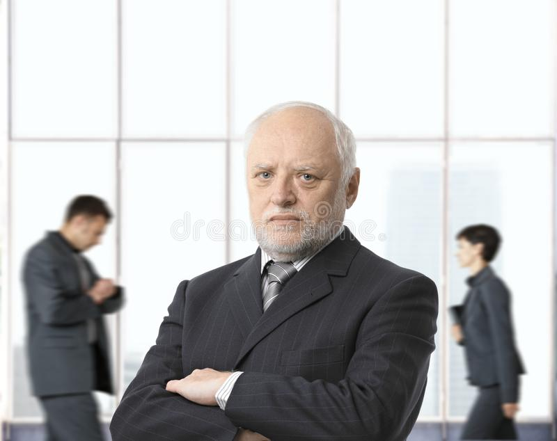 Severe senior businessman stock image