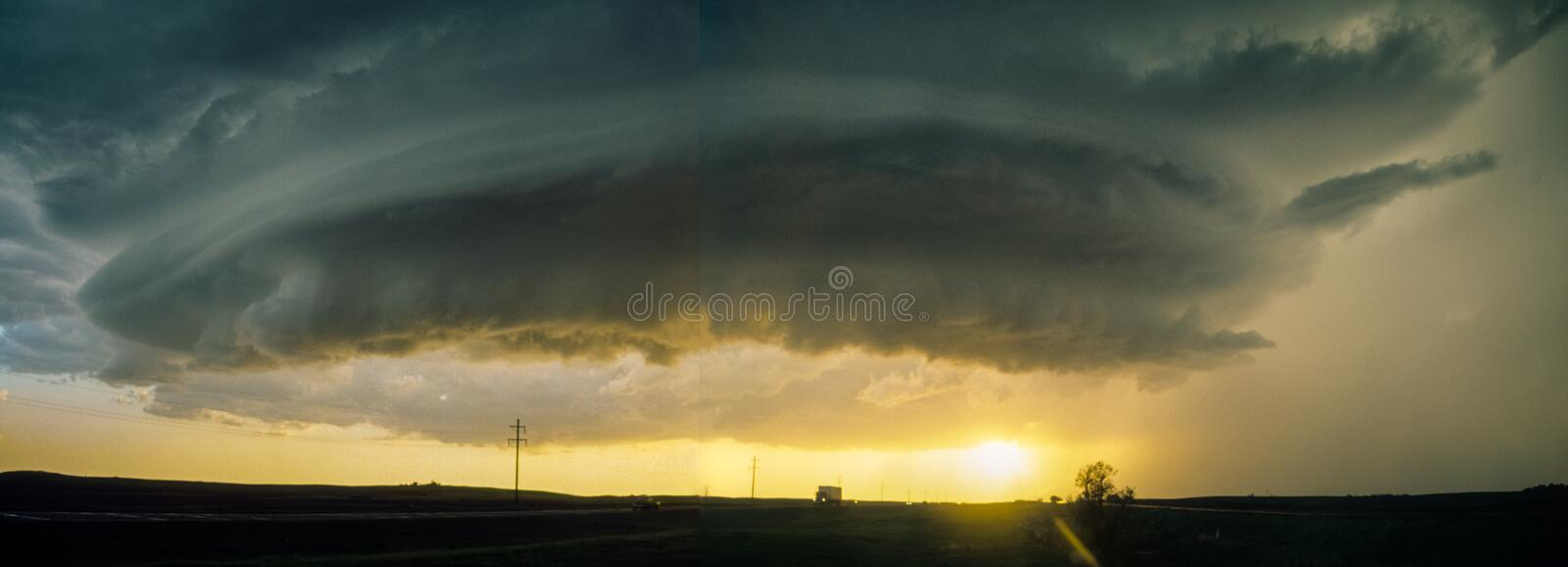 Panoramic composite of a rotating `mothership` wall cloud of a supercell thunderstorm over the plains of North Dakota. Severe warned thunderstorm near Balfour stock photos