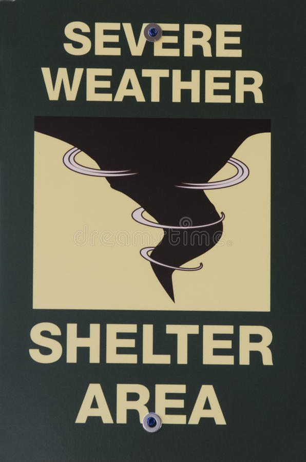 Severe Weather Shelter Area Sign. This is a Tornado storm shelter sign Green, Black and yellow colors. Close up stock photos