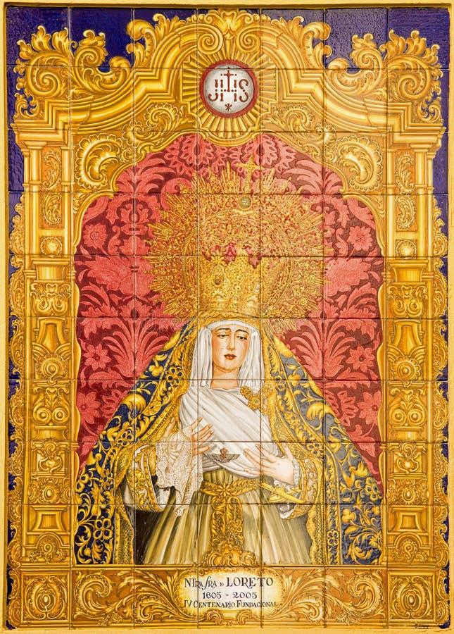 Sevilha - Madonna telhado cerâmico de Loreto na igreja Iglesia de San Isidoro por J Soriano imagem de stock royalty free