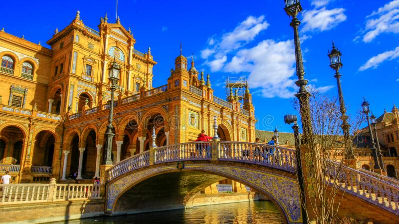 Architectural details of the buildings and brdges of Plaza de Espana in Seville, Spain, with tourists stock photography