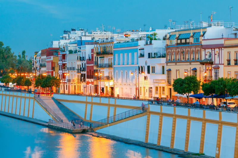 Sevilla. City embankment along the Guadalquivir. View of urban embankment in Seville along the Guadalquivir river at sunset. Spain. Andalusia stock images