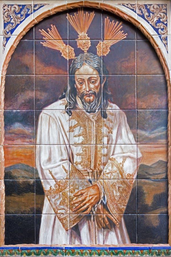 Sevilla - der keramische mit Ziegeln gedeckte Christus in der Bindung stockfotos