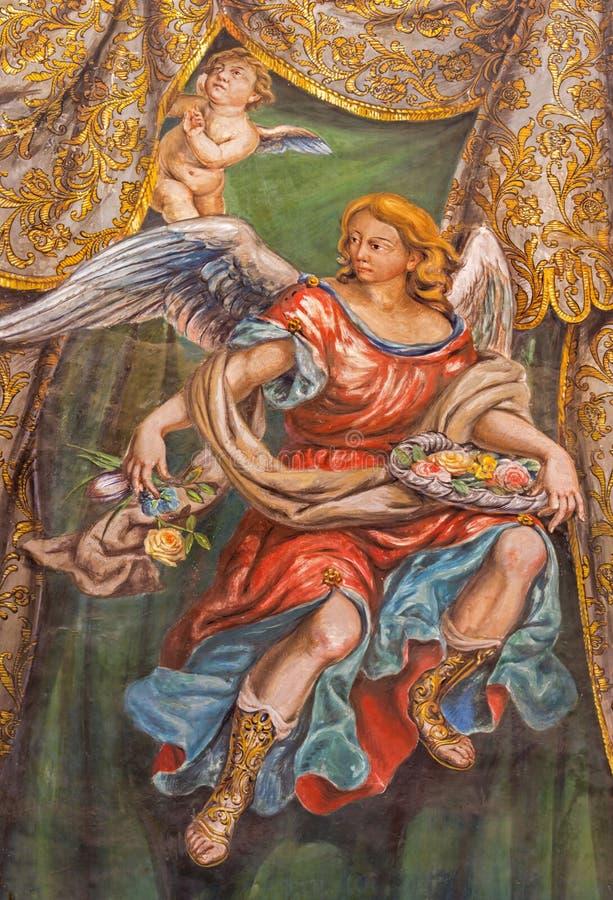 Sevilla - el fresco del ángel con las rosas en la iglesia Hospital de los Venerables Sacerdotes fotos de archivo libres de regalías