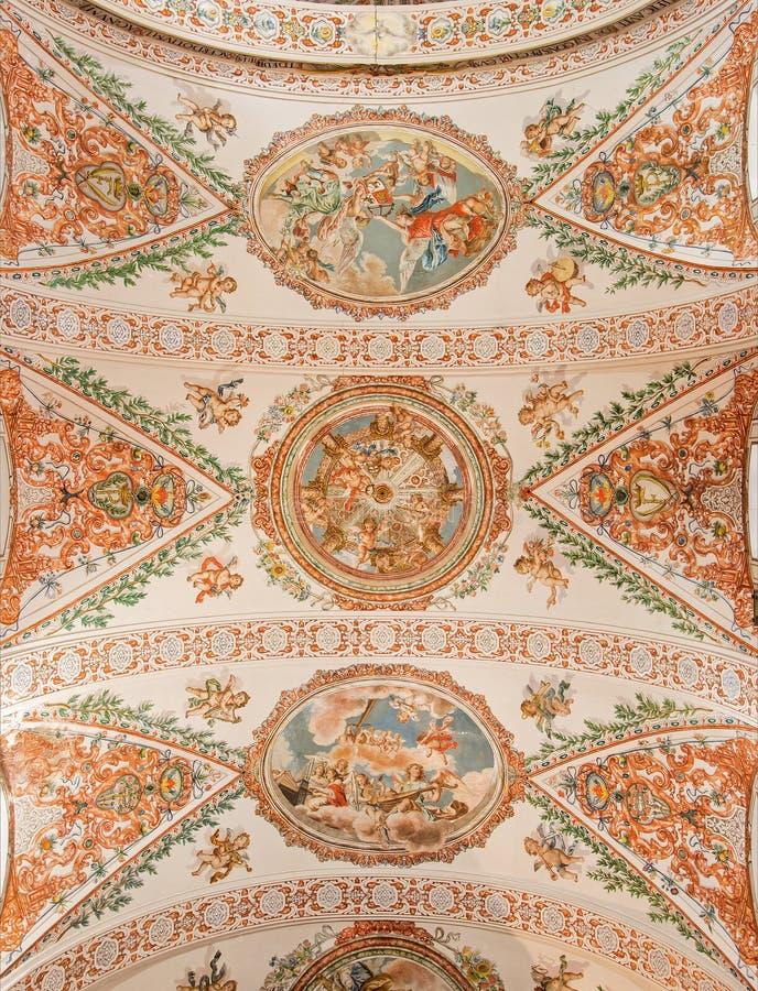 Sevilla - el fresco en el techo en la iglesia Hospital de los Venerables Sacerdotes fotografía de archivo
