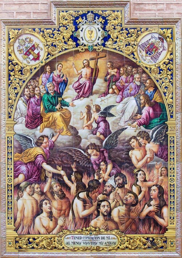 Sevilla - escena pasada tejada de cerámica del juicio de Ramos Resano en la fachada de la iglesia Iglesia de San Pedro foto de archivo libre de regalías