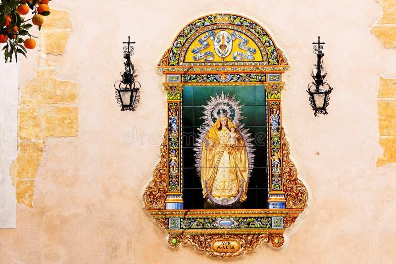 Sevilla, Jungfrau- Mariakeramisches Bild stockbilder