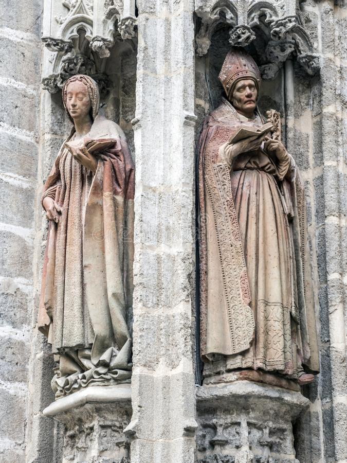 Statues of saints carved in stone, detail of exterior in the Cathedral of Seville, Andalusia, Spain royalty free stock image
