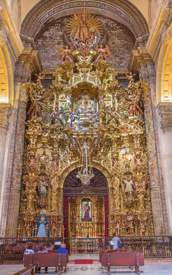 Seville - The altar of Sacramental chapel in baroque Church of El Salvador (Iglesia del Salvador). SEVILLE, SPAIN - OCTOBER 28, 2014: The altar of Sacramental stock photos
