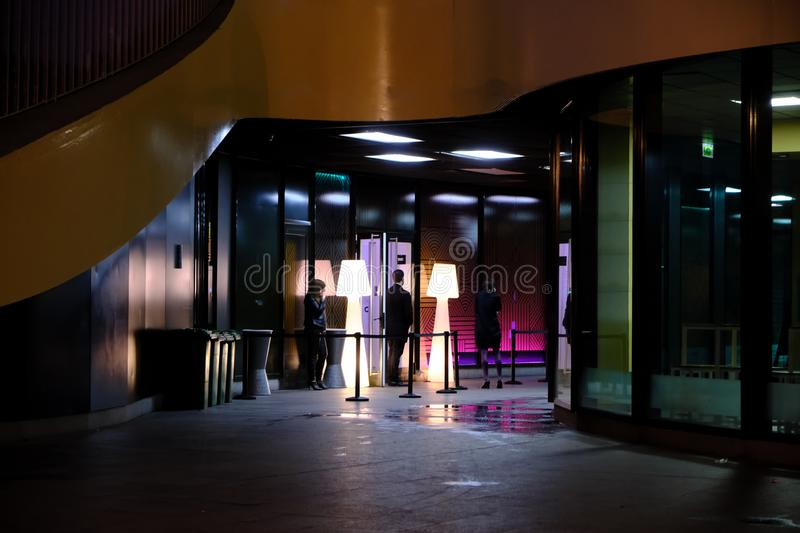 Seville - April 2019 SPAIN entrance hotel under the metropol parasol with butler and peoples at night waiting VIP very important. People arriving - night life royalty free stock photos