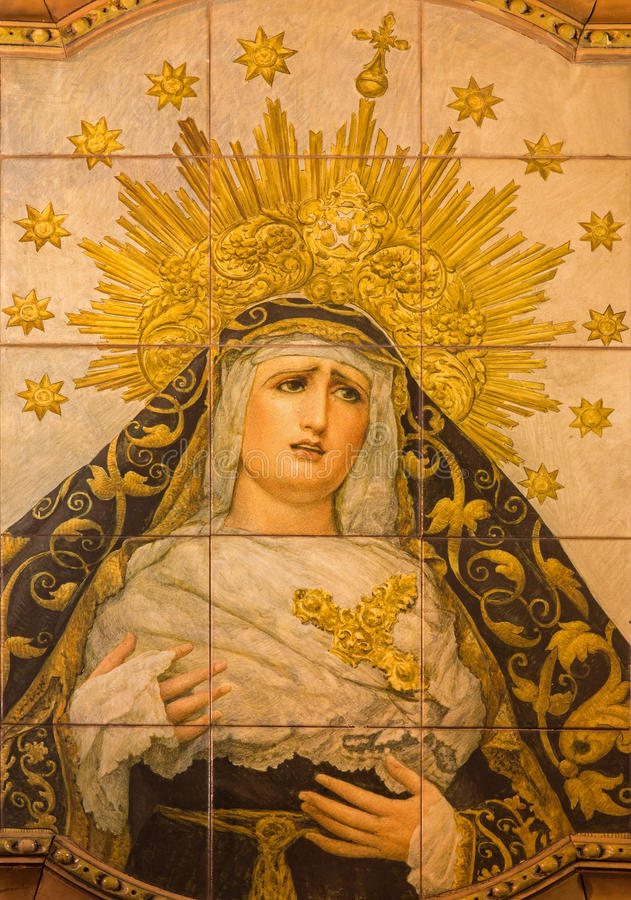 Seville - The ceramic tiled, cried Madonna on the facade of church Iglesia San Bonaventura. SEVILLE, SPAIN - OCTOBER 29, 2014: The ceramic tiled, cried Madonna royalty free stock image
