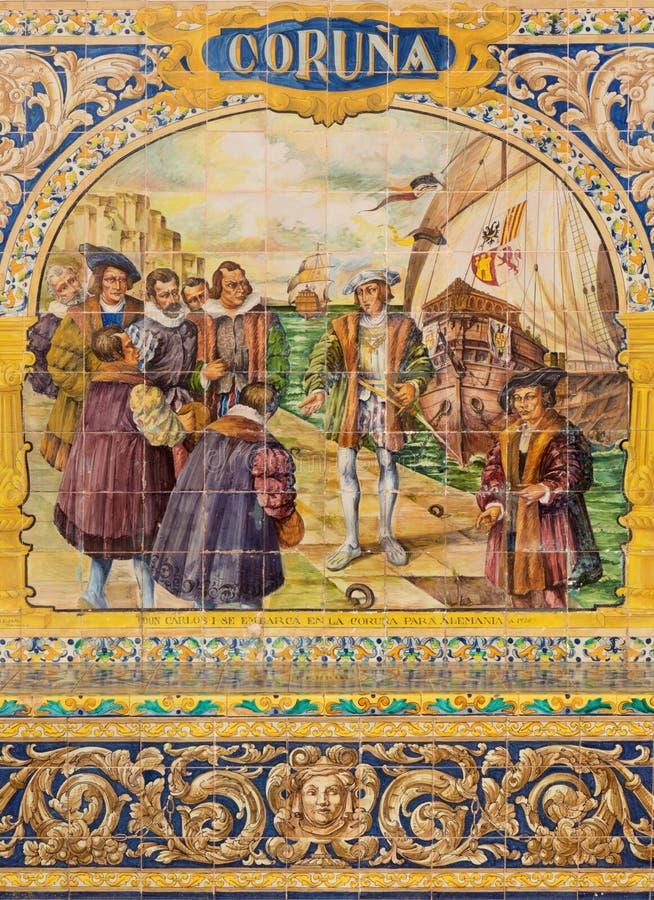Seville - Corunaen som en av de belade med tegel 'landskapalkoven längs väggarna av plazaen de Espana arkivfoto