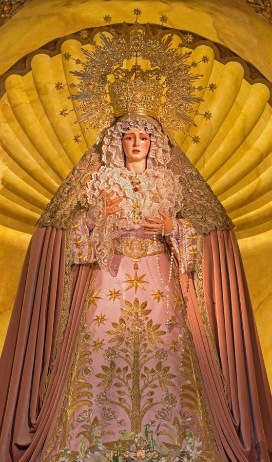 Seville - cried Virgin Mary statue on the main altar in church Iglesia de Santa Maria de los Angeles. SEVILLE, SPAIN - OCTOBER 28, 2014: The cried Virgin Mary royalty free stock photos