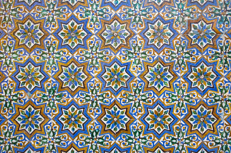 Seville - The detail of tiles in mudejar style in courtyard of Casa de Pilatos. SEVILLE, SPAIN - OCTOBER 28, 2014: The detail of tiles in mudejar style in royalty free stock photography