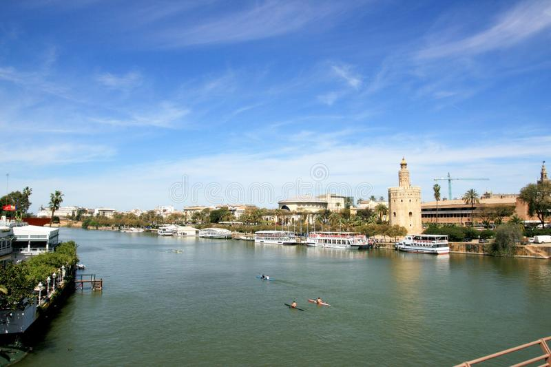 Seville, Guadalquivir river & buildings landscape royalty free stock photo