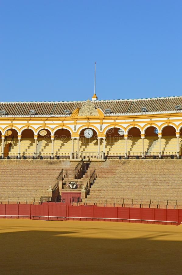 Seville - interior -Seats in the sun. The Plaza de toros de la Real Maestranza de Caballería de Sevilla stock images