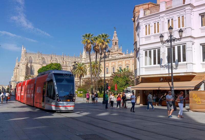 Seville. A modern tram on the route. Seville, Spain - November 2, 2016: A modern comfortable tram on the city street. Seville. Andalusia Spain royalty free stock photography