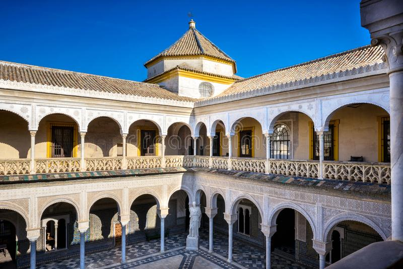 Seville, Patio Principal of La Casa De Pilatos. The building is a precious palace in mudejar spanish style. Spain. Casa de Pilatos is a palace in Seville. The stock photo