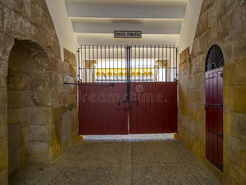 Red gate in the Plaza de Toros Arena in Seville royalty free stock image