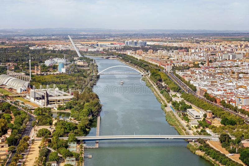 Seville riverfront, Spain. Aerial view of beautiful Seville with brigdes on the river royalty free stock photos