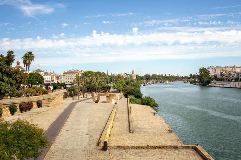 Seville riverfront with Tower of Gold, Spain. Cityscape of Seville with Torre del Oro in the background stock photo