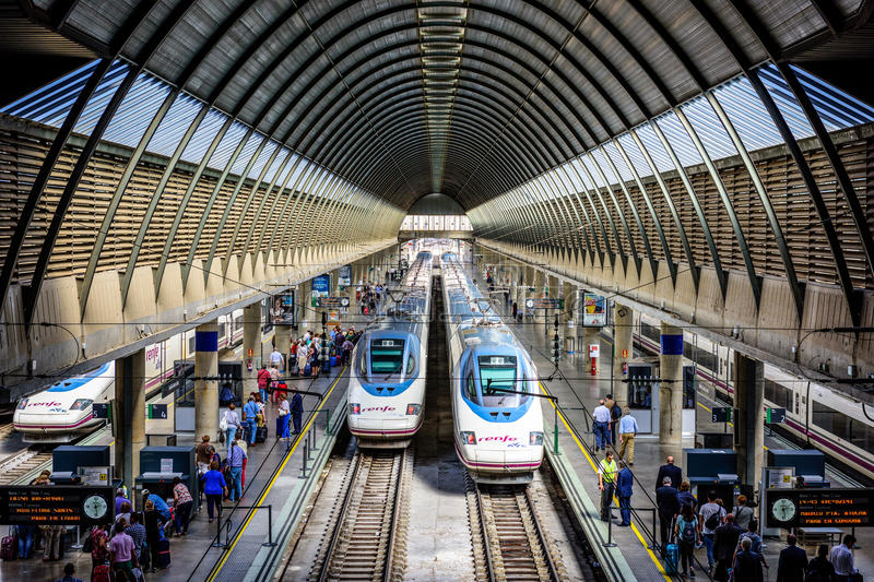 Seville Santa Justa Station. SEVILLE, SPAIN - OCTOBER 8, 2014: Passengers and trains at Santa Justa Station. The station is the third busiest in Spain with an stock image