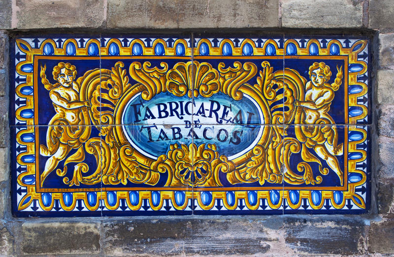 Seville, Sevilla, Spain, Andalusia, Iberian Peninsula, Europe,. Spain, 14/04/2016: ceramic sign of the Royal Tobacco Factory Real Fabrica de Tabacos, an 18th royalty free stock images
