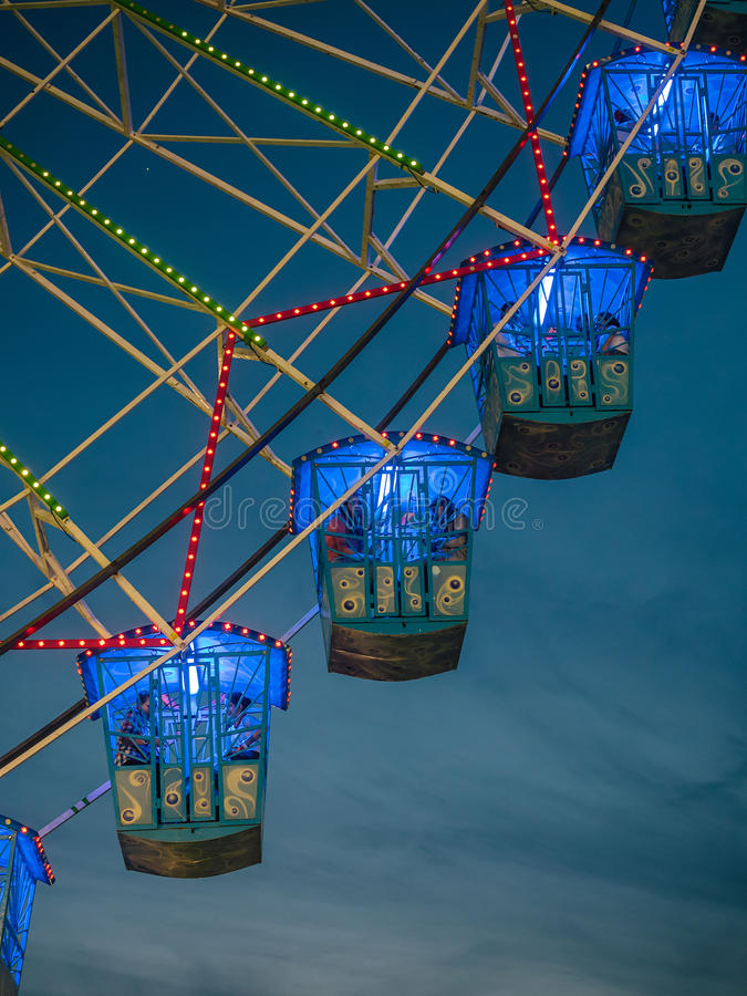 Seville, Spain - April 23, 2015: Detail of ferris wheel illuminated at night. In the april fair of Seville stock images